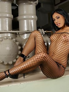 Brunette Hot In Net Stockings Posing In the Industries