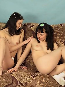 Two nice brunettes with innocent looks posing naked and touching their holes