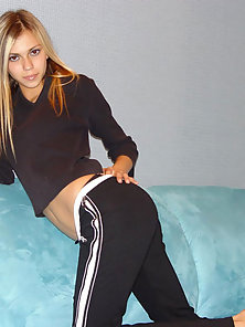 Sweet Teen on Blue Sofa Striping Her Outfit in Naughty Action