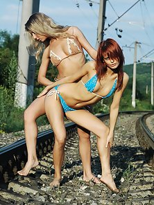Artistic babes are posing in bikinis at train roads