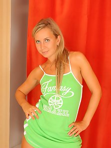Green Dressed Hot Teen Blonde Babe Giving Some Sexually Look On the Bed