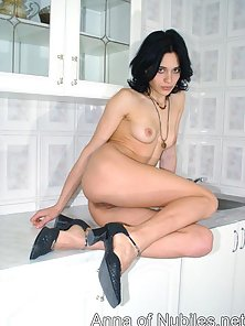 Short Haired Brunette Chick Showing Her Sexy Nude Body with Many Poses
