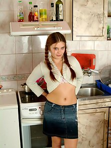 Pigtail Brunette Babe Posing Naked In Kitchen Room
