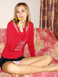Sexy Teen Sucking Lollipop and Teasing Her Body