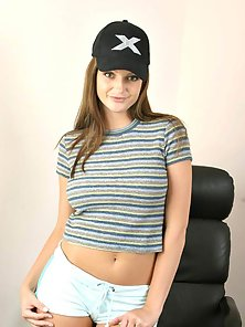 Teen Chick with Cap Hides Her Nipples with Hands