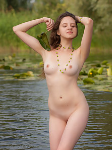 Gorgeous flower babe exposing her body outdoor