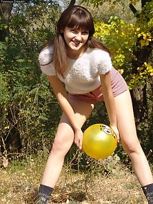 Sensual Cute Teen Chick Playing With Football in Naked State in Public