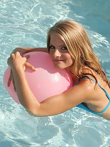 Stunning Skinny Blonde Chick Playing Air Ball in the Pool in Nude