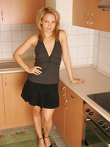 Cute Chick Stripping Out Of Her Black Dress In Her Kitchen And Then Waiting For Sex