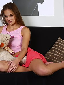 Sexy Brunette Busty Playing With Teddy Beer in Bare Breast Pose