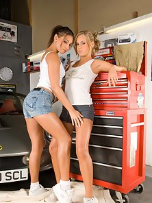 Blonde And Brunette Chicks Makes Lesbian Sex Action in the Car Workshop