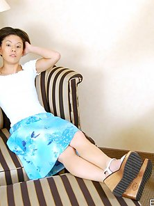 Super Slutty Young Asian Girl Tiny Viewing Her Sexy Figure on the Couch