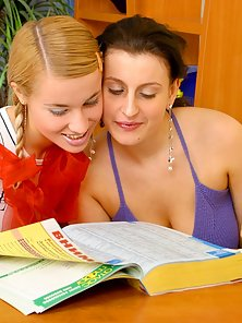Hot Brunette Teacher Is In Lesbian Action with the Blonde Slim Student