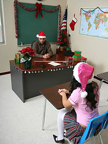 Cute Brunette Student Enjoying the Merry Christmas with Her Teacher in the Classroom