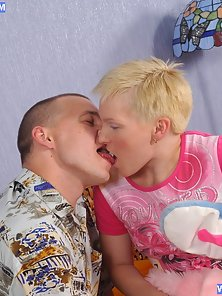 Short Haired Blonde Babe Deeply Sucking a Huge Cock on the Bedroom