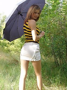Cute Hot Chick with Black Umbrella Doing Some Extra Ordinary Posses In Outdoor