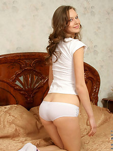 White Dressed Pretty Sweet Posing In Several Ways on the Bed