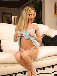Attractive Looking Hot Lingerie Blonde Babe Enjoying Solo Sex Action on the Sofa