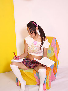 Pretty Brunette Schoolgirl Gets Erotic While Studying Wildly