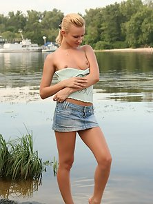 Solo blonde making love to herself at lake
