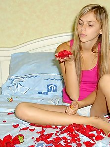 Hot Blonde Babe Preparing Her Bed with Rose for Honeymoon