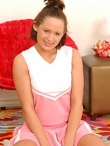 Horny Teen Emery Pleased Herself by a Red Dildo