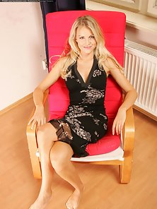 Black Lingerie Pretty Blonde Babe Presenting Her Massive Tits on the Chair