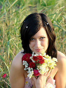 Sweet Sexy Brunette Babe Sexually Kissing Some Flower in Outdoor Grass Field