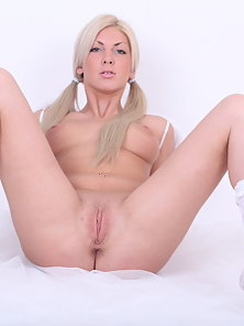 Small titty solo blonde is showing off her wet cunt on camera