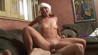 Tattooed Brunette Babe in Santa Dress Ride on Throbbing Prick
