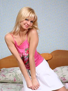 Naughty Sweet Blonde Teen Shows Her Trimmed Pussy on the Bed