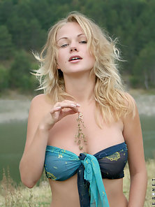 Looking Pretty Blonde Milana Exposing Her Body over the Mountain Breeze