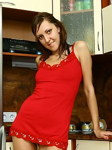 Ultra Slim Adrianne with Red Dress Fingering Her Pussy in the Kitchen