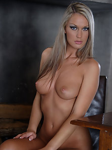 Seductive Busty Blonde Slowly Striptease and Flashing Her Hanging Jugs
