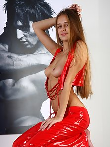 Sexy Brown Headed Babe Stripes Out Her Red Latex and Flashed Up Her Boobs