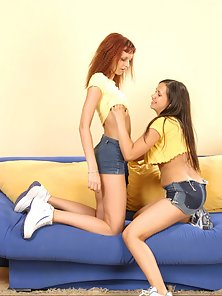 Two Young Lesbian Girls Are Playing With Their Boobs