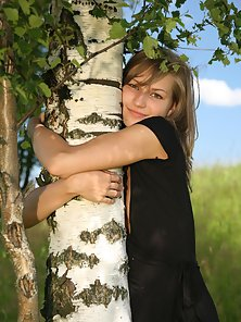 Black Dress Babe Hugging a Tree and Stripping Her Dress On Outdoor Place