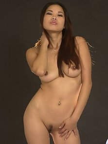 Charming Asian Babe with Flawless Body Nagging and Posing