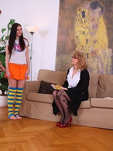 Nasty Teacher and Her Coeds Played With a Nice Slim Dildo