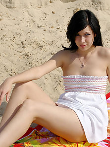 Petite Brunette Hot Rubbing Her Boobs with Dildo on Beach