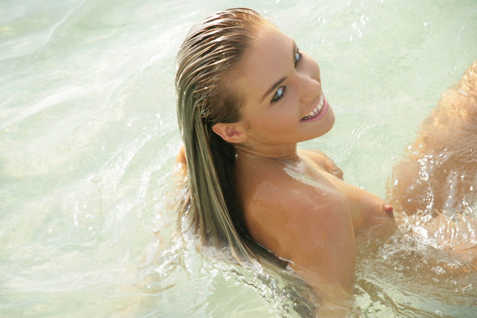 Nude blonde girls in the water