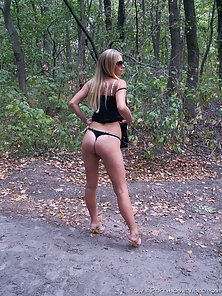 Blonde amateur beauty is stripping and posing on road