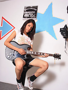 Hot Brunette Chick Playing With Guitar Exposing Her Juicy Cunt