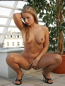 Blonde Babe Showing Her Sexy Poses On the Top Floor