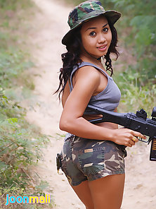Gorgeous asian commando Joon stripping in jungle