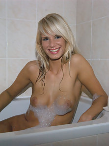 Hot Skinny Blonde Chick Posing Her Round Boobs On the Bathtub