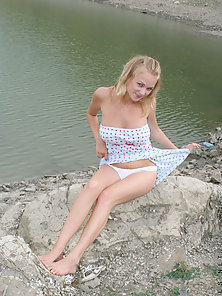 Beauty Blonde Babe Milana Posing Her Sexy Figure near The River
