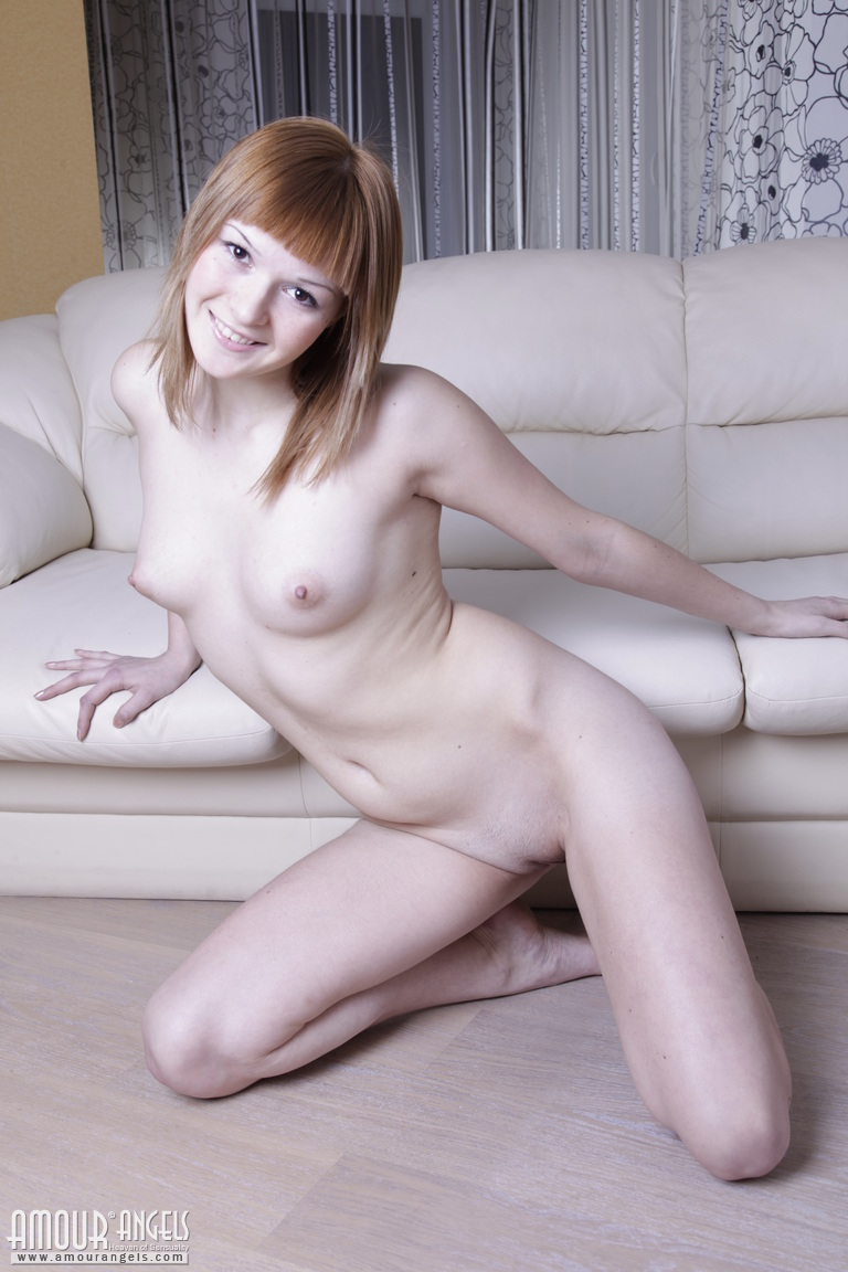 Ang Naked stunning slim redhead flaunts flawless naked shape on couch
