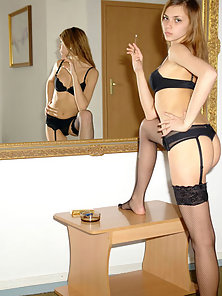 Tall Babe in Horny Lingerie Smoking Cigar In Front Of Mirror