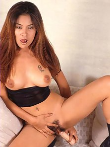 Charming Asian Babe in Shorts Squeezes Boobs and Toys Twat